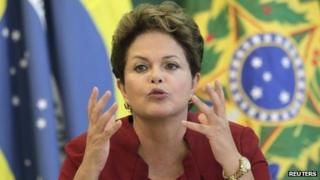 Dilma Rousseff speaks with reporters on 27 December 2012