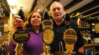 Daphne and Nigel Leck behind the bar at the Merrie Lion pub in Fenny Compton