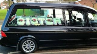 Hearse carrying the coffin