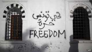 File photo of graffiti at a government building during a protest in Tunisia on 21 January 2011 a week after former President Zine al-Abidine Ben Al fled