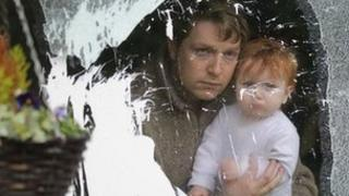 Michael Bower with his daughter after the attack on his house