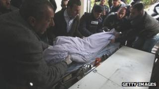 Palestinian police in Ramallah deliver the body of Samir Ahmed Awad to the mortuary