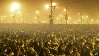 Tens of thousands of Hindu devotees crowd a large field on the banks of the Sangham or confluence of the Yamuna and Ganges rivers as they surge forward slowly and hope to take a dip in the waters during the Kumbh Mela in Allahabad on January 14, 2013.