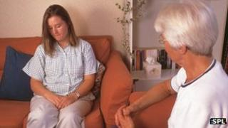 Therapist talking to a patient