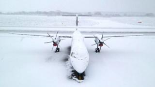 A grounded plane at the snow-strewn Southampton Airport on Friday morning