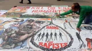 An artists works on a banner calling for the death sentence for rapists in Delhi, 16 January 2012