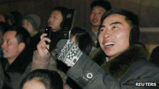 North Koreans take photos on mobile phones at New Year in Pyongyang (1 Jan 2013)