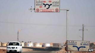 A car drives past the gas plant on the outskirts of In Amenas, in Algeria, where militants took dozens of foreign workers hostage (18 January 2013).