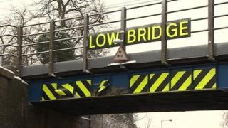 Low bridge damaged at Baldock, Herts, by lorry