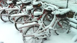 Royal Mail bikes covered in snow
