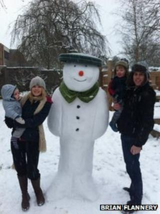 Brian Flannery with Shauna and a snowman built for Jack and William Flannery in Dorridge
