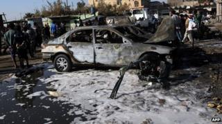 Aftermath of car bomb in Shula district of Baghdad. 22 Jan 2013