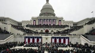 President Barack Obama waves after his Inaugural speech at the ceremonial swearing-in on the West Front of the US Capitol