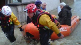 RNLI flood rescue team helping people in St Asaph