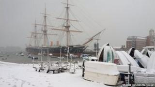 Snowy scene at Portsmouth Dockyard with HMS Warrior in the background
