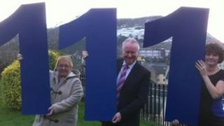 Health Secretary Alex Neil launching the new number