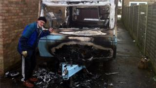 Roy Griffiths with his burned out caravan