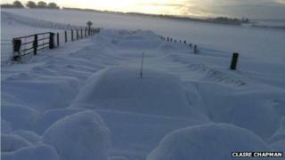 Car under snow in Daviot