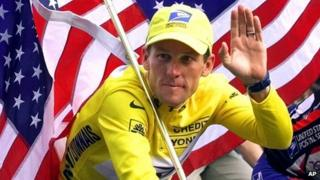 Lance Armstrong celebrates after winning the 2000 Tour de France