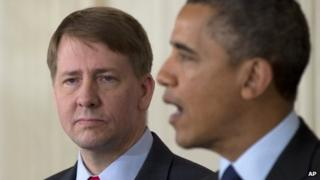 Richard Cordray stands left as President Barack Obama announces in the State Dining Room of the White House in Washington, 24 January 2013