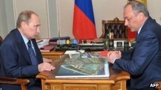 Russia's President Vladimir Putin and former President of Dagestan Magomedsalam Magomedov