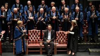 Liam Neeson receives a standing ovation