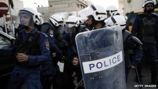 A protestor is arrested by riot policemen during a demonstration 18 January 2013