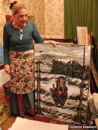 Roma artist and author Ceija Stojka with one of her paintings (image courtesy photographer Theresa Kennedy, from the Forget Us Not documentary, producer Heather E Connell)