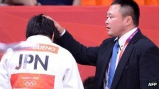 Japanese women's judo head coach Ryuji Sonoda (R) at the London 2012 Olympic Games on 31 July 2012