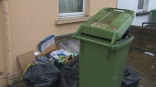 Household rubbish piled up outside a house in Cheltenham