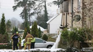 Police and fire officers outside house in Fernhurst
