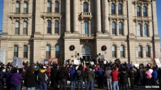 Protesters gathered in front of the of the Jefferson County Courthouse in Steubenville, Ohio, 5 January 2013
