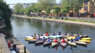 Children from Laburnum Boat Club in kayaks on the canal