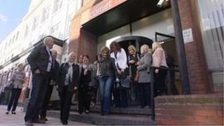 Staff leaving Comet office in Hull