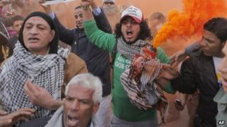 Egyptians shout slogans during anti-President Mohammed Morsi protest in front of the presidential palace in Cairo