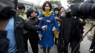 Kim Lee walks into a court for her divorce trial in Beijing, China, on 22 March 2012