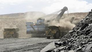A hydraulic shovel loads a truck at an open cast diamond mine in Botswana