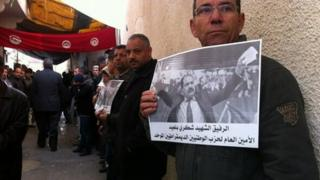 Tunisians gather for Friday's funeral, 7 February