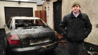Willie Frazer standing at the scene of the arson attack