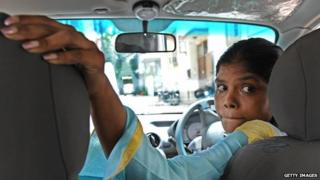 A driver trained by the Azad Foundation in Delhi