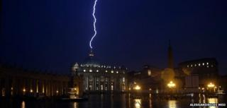 A flash of lighting is seen over St Peter's Basilica