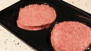 Two uncooked burgers