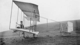 Christopher Howard Carlyon at the helm of his 22ft wingspan glider on Coedcae field