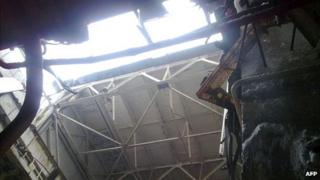 Photo from Ukraine's nuclear authorities showing the hole in the roof at the Chernobyl plant