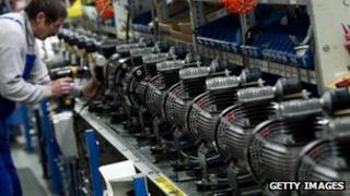 German man works on a production line