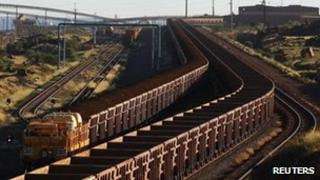A train loaded with iron ore travels towards the Rio Tinto Parker Point iron ore in western Australia