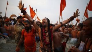 Naga Sadhus take ritual dips at Sangam on Basant Panchami in Allahabad on Friday, Feb 15, 2013.