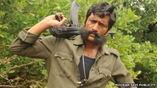 Actor Kishore playing the role of Veerappan