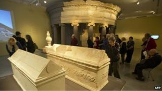 Visitors examine sarcophagi and what is believed to be the burial place of Herod brought from Herodium