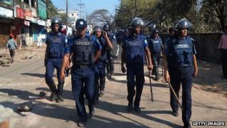 Bangladeshi police patrol on the street after clashes with Jamaat-e-Islami activists in Cox's Bazar